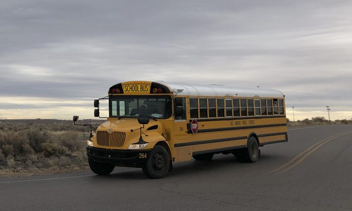 A school bus evacuates students from Sue V. Cleveland High School  after a shot was fired on the campus in Rio Rancho, New Mexico, on Feb. 14, 2019. (Russell Contreras/AP)