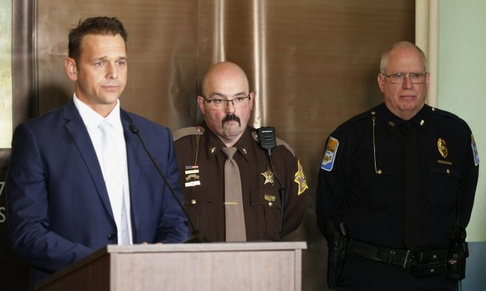 Carroll County Prosecutor Nick McLeland, from left, Carroll County Sheriff Tobe Leazenby and Delphi Police Chief Steve Mullin attend a news conference in Delphi, Ind., on Feb. 13, 2019. (Ron Wilkins/Journal & Courier via AP)