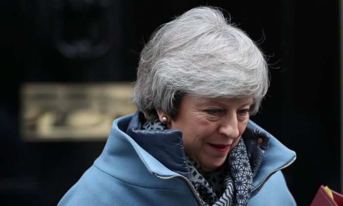 Britain's Prime Minister Theresa May outside Downing Street in London on Feb. 13, 2019. (Hannah McKay/Reuters)