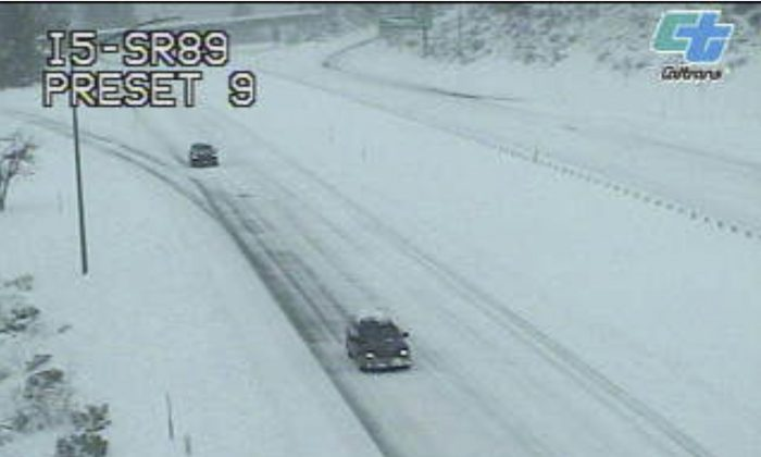This image from a Caltrans traffic camera shows snow on Interstate 5 in Weed, Calif., on Feb. 13, 2019. (Caltrans via AP)