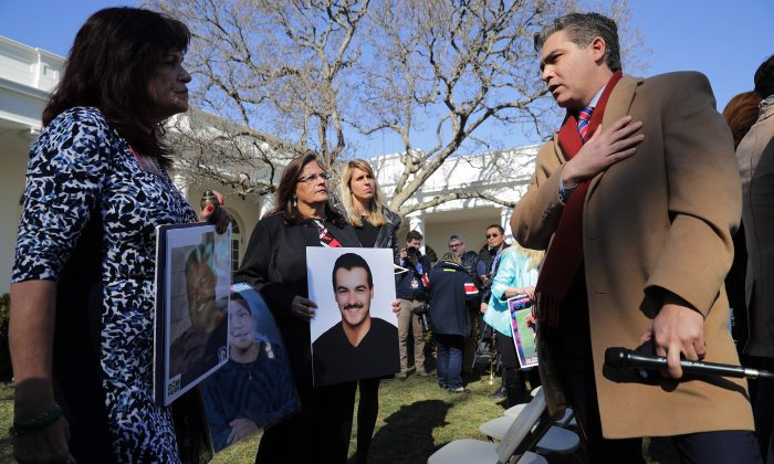 CNN's Jim Acosta (R) talks with 'Angel moms,' including Sabine Durden (L), following a news conference with U.S. President Donald Trump in the Rose Garden at the White House in Washington, on Feb. 15, 2019. (Chip Somodevilla/Getty Images)