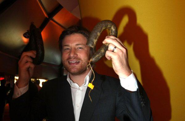 Jamie Oliver holding sausages