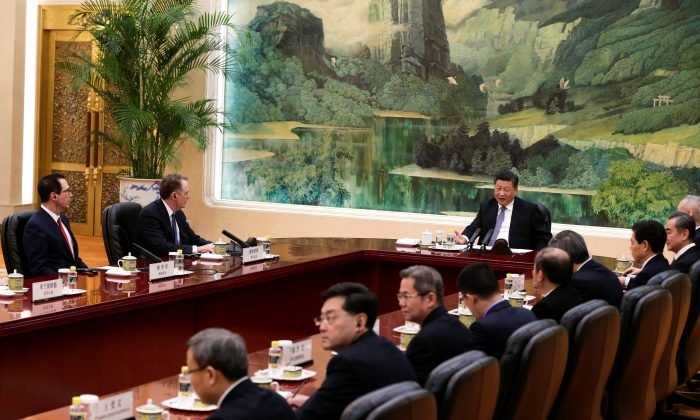 Chinese leader Xi Jinping, speaks as he meets with U.S. Trade Representative Robert Lighthizer, second from left, U.S. Treasury Secretary Steven Mnuchin, left, and Chinese officials at the Great Hall of the People in Beijing on Feb. 15, 2019. (Andy Wong/Pool via Reuters)