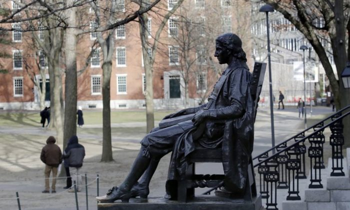 The John Harvard statue looks over Harvard Yard at Harvard University in Cambridge, Mass. A final round of arguments is scheduled for in federal court in Boston in a trial alleging racial bias in the university's admissions system on Wednesday, Feb. 13, 2019. (AP Photo/Charles Krupa, File)