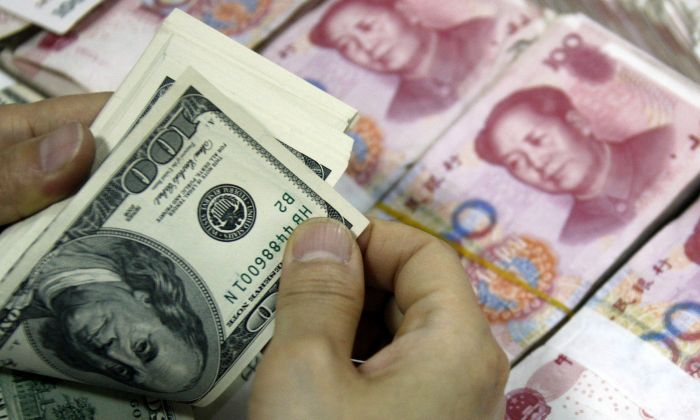 Chinese and U.S.tariffs are heating up. (STR/AFP/Getty Images)