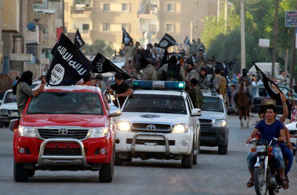 ISIS terrorists waving flags