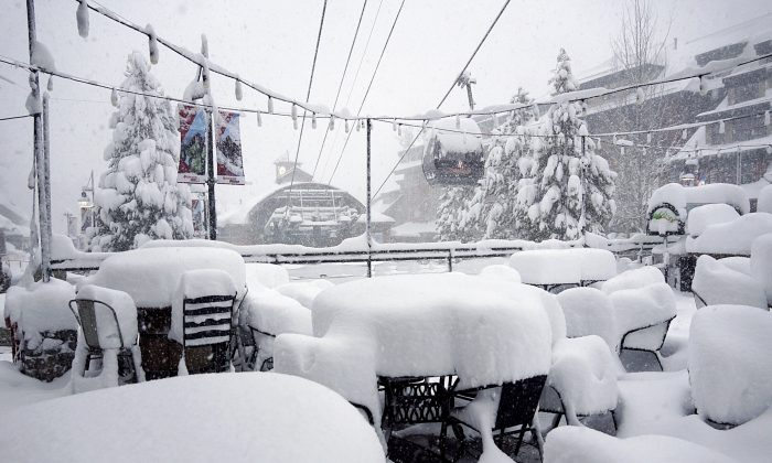 This Friday, Feb. 15, 2019, photo released by Heavenly Mountain Resort shows snow covering chairs and ski equipment at Heavenly Mountain Resort near South Lake Tahoe, Calif. (Duncan Kincheloe/Heavenly Mountain Resort via AP)