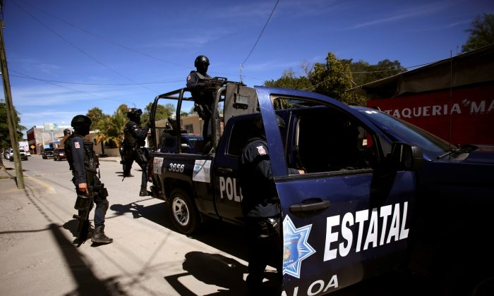 State police patrol ahead of the visit of Mexico's President Andres Manuel Lopez Obrador to Badiraguato, in the Mexican state of Sinaloa, Mexico on February 15, 2019. (Daniel Becerril/REUTERS)