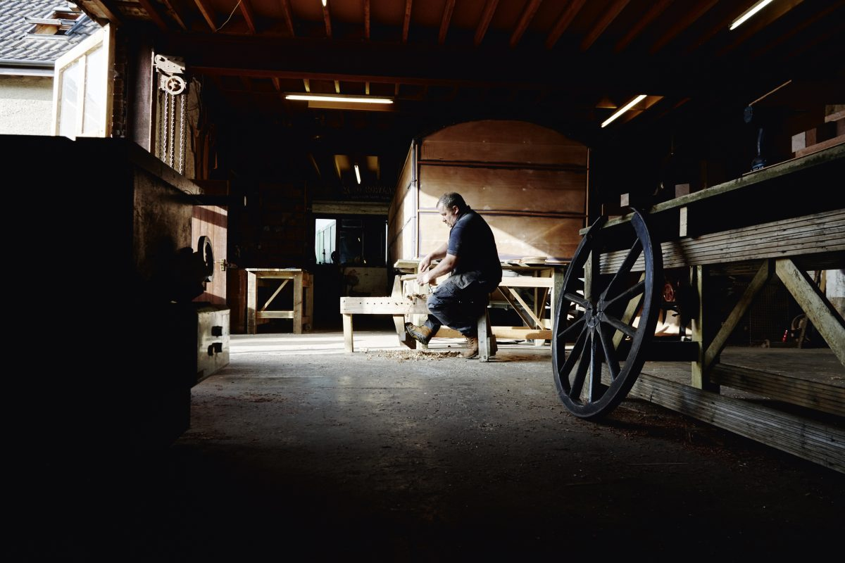 Cart wheel making studio man working