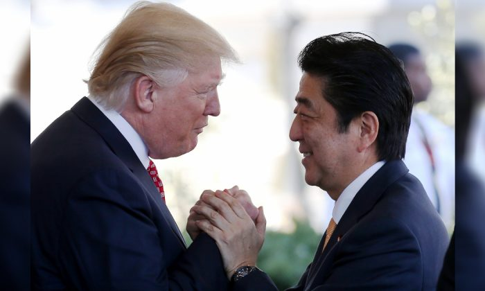 President Donald Trump (L) greets Japanese Prime Minister Shinzo Abe as he arrives at the White House on February 10, 2017 in Washington, DC. The two will hold a bilateral meeting and press conference today at the White House. (Mario Tama/Getty Images)