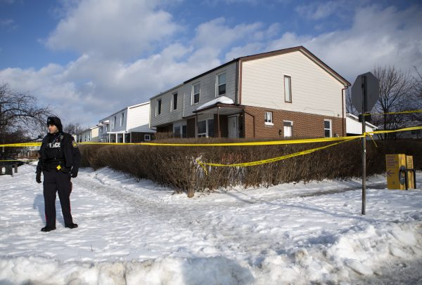 Police monitor the scene outside of a house where a young girl was found dead in Brampton, Ont. on Feb. 15, 2019. (THE CANADIAN PRESS/Andrew Ryan)