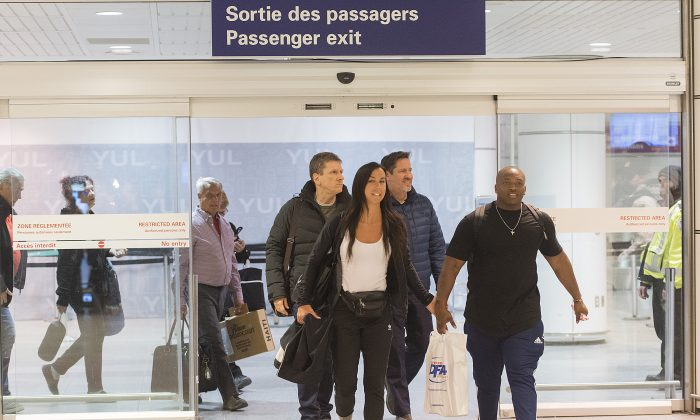 Passengers arrive at Trudeau airport in Montreal on Feb. 16, 2019. More than 100 Quebec tourists who had been trapped in Haiti amid violent street protests were flown back to Montreal that day. (THE CANADIAN PRESS/Graham Hughes)