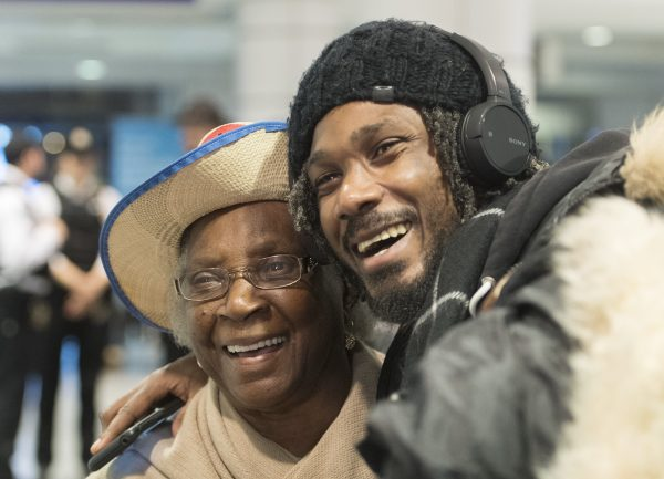 A woman and man hug at Trudeau airport in Montreal on Feb. 16, 2019. More than 100 Quebec tourists who had been trapped in Haiti amid violent street protests were flown back to Montreal. (THE CANADIAN PRESS/Graham Hughes)
