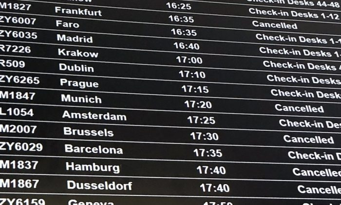 A departure board showing the BMI flights cancelled following the collapse of the airline, at Bristol Airport in Bristol, England, on Feb. 17, 2019. (PA via AP)