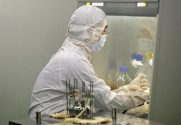 A lab technician works at a Chinese biotech firm in Beijing on Aug. 24, 2009. (Peter Parks/AFP/Getty Images)