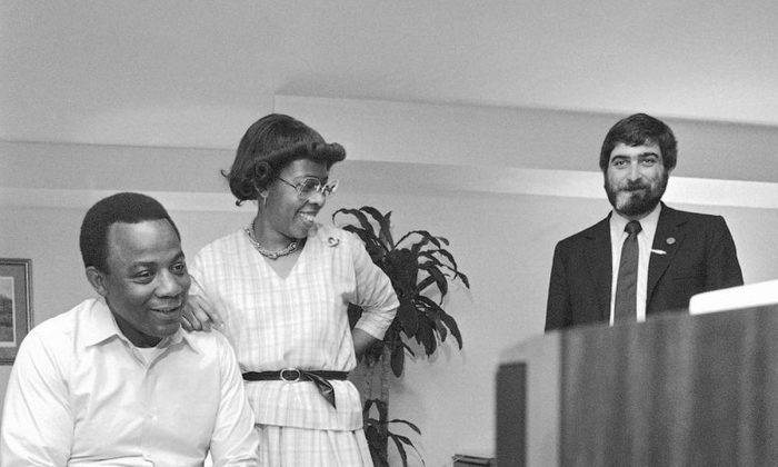 In this May 17, 1983 file photo, W. Wilson Goode and his wife Velma smile as they react to the news on television of a heavy black voter turn out in west Philadelphia in the Democratic primary election at the Philadelphia Centre Hotel. Pollster Patrick Caddell is on right. Caddell, the pollster who helped propel Jimmy Carter in his longshot bid to win the presidency has died, a colleague said Saturday night, Feb. 16, 2019. He was 68. (AP Photo/George Widman, File)