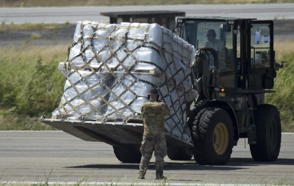 A truck is loaded with humanitarian aid for Venezuela after U.S. Air Force C-17 aircrafts landed at Camilo Daza International Airport in Cucuta, Colombia, on the border with Venezuela on Feb. 16, 2019.(Raul Arboleda/AFP/Getty Images)