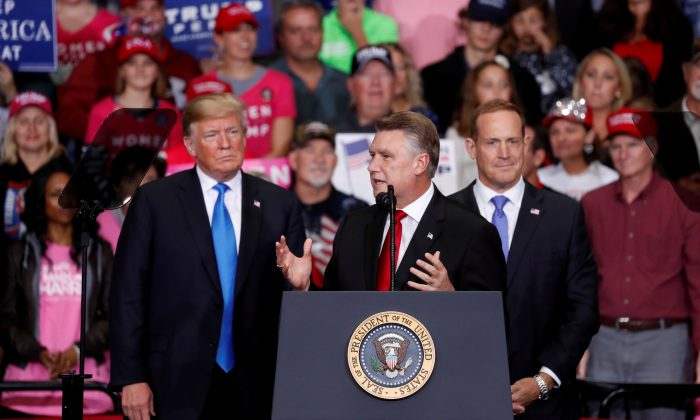 Mark Harris, Republican candidate from North Carolina's 9th Congressional district, speaks as President Donald Trump looks on during a campaign rally in Charlotte, N.C., on Oct. 26, 2018. (REUTERS/Kevin Lamarque/File Photo)