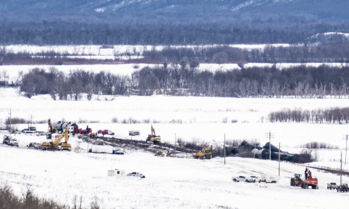 Excavators work at the site of a train derailment ten-kilometres south of St. Lazare, Man. on Feb. 16, 2019. (The Canadian Press/Michael Bell)