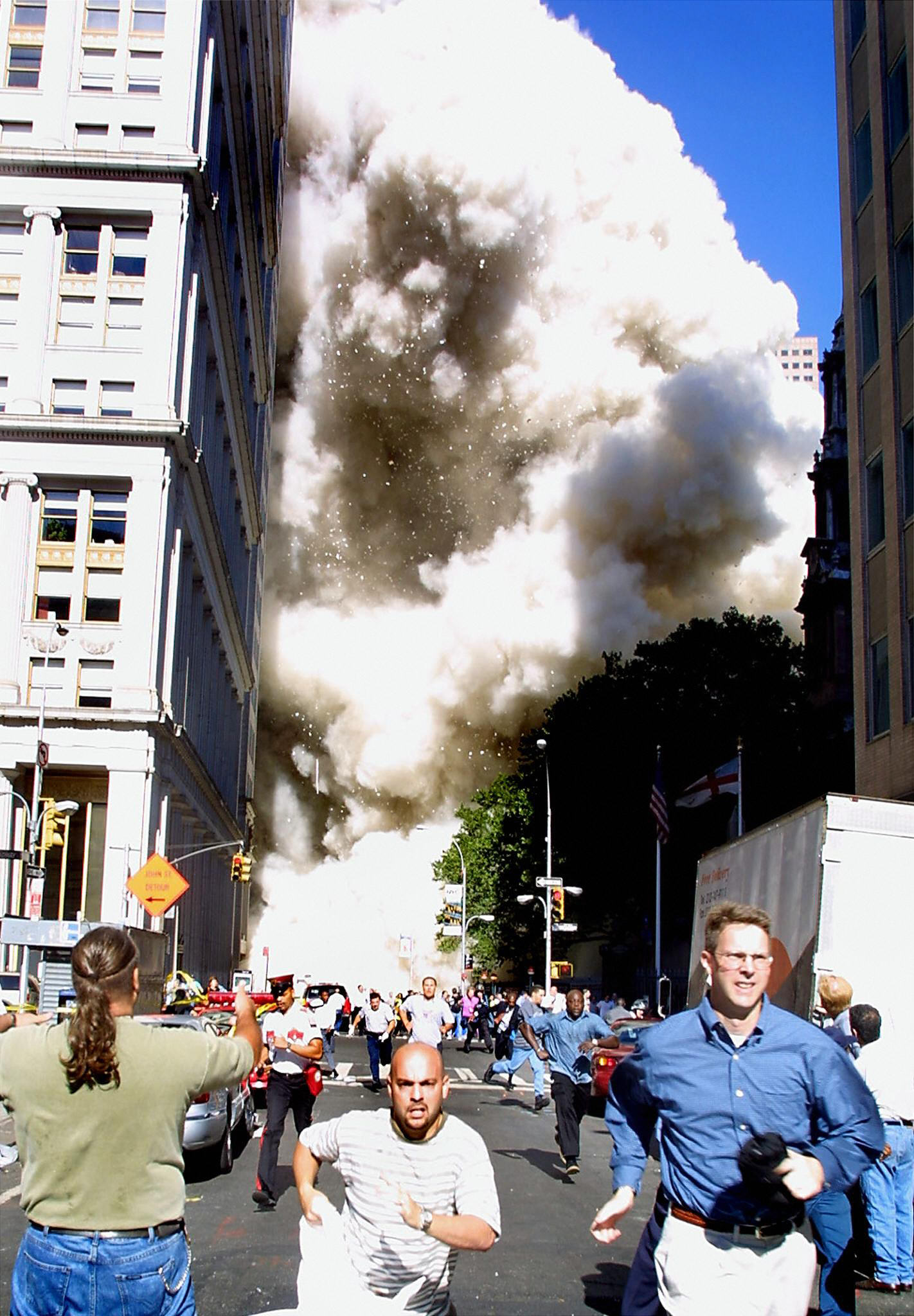 Pedestrians running from the scene as one of the World Trade Center