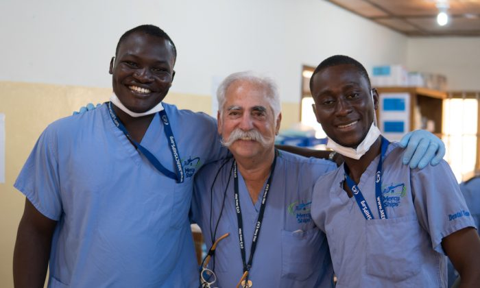 Dr. Elliot Siegel with two local dental assistants in Africa. (Katie Cowell)