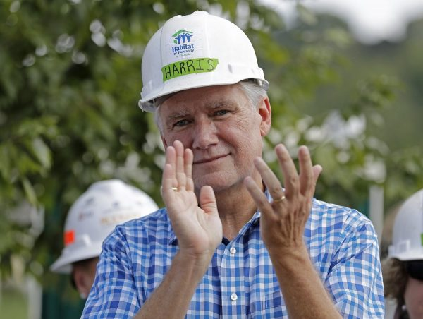 Republican congressional candidate Mark Harris applauds during a Habitat For Humanity building event in Charlotte, N.C.