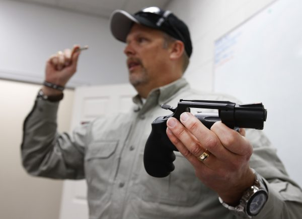 Gun instructor Mike Stilwell, demonstrates a revolver