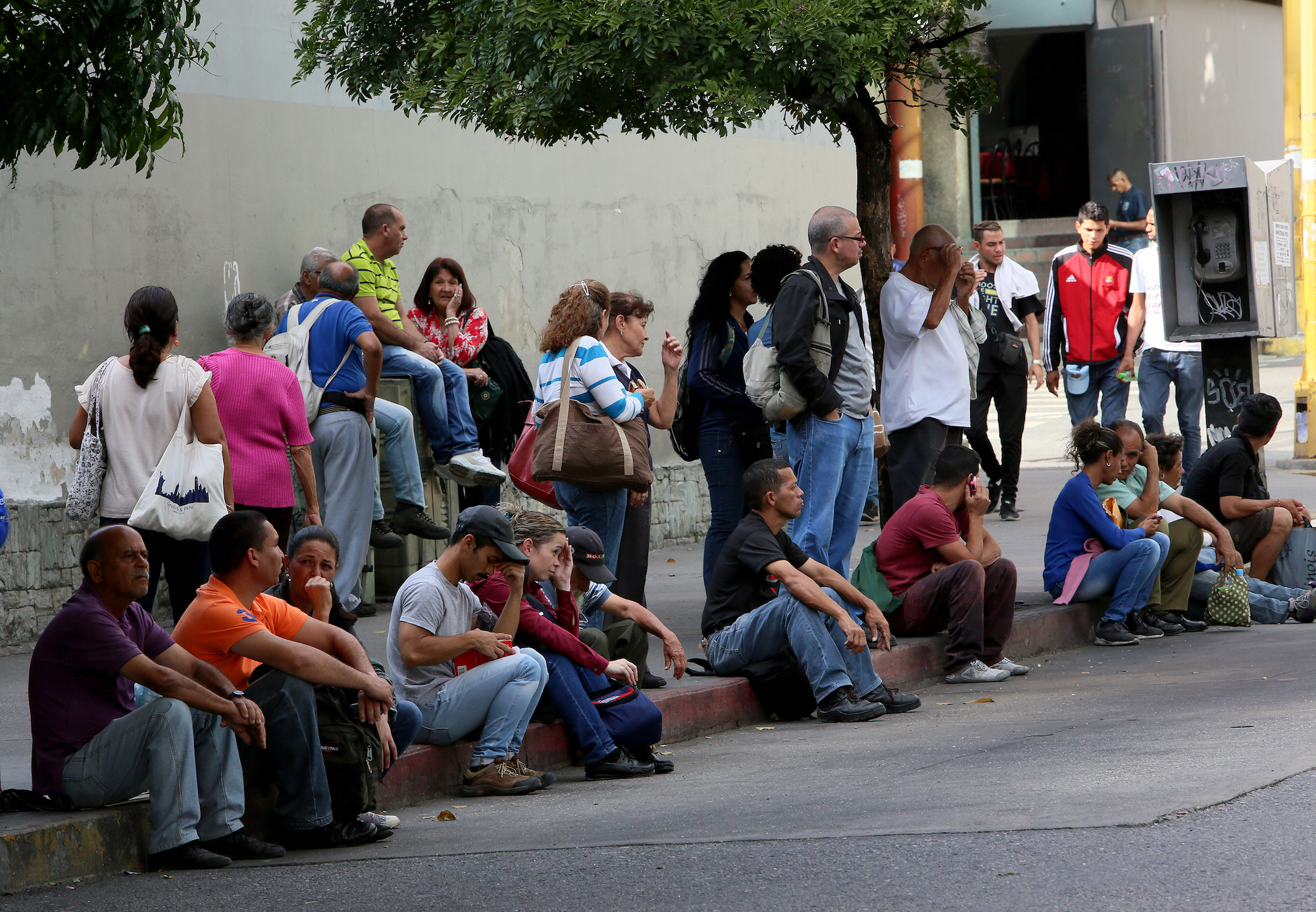 People make long queues to take the bus in Venezuela