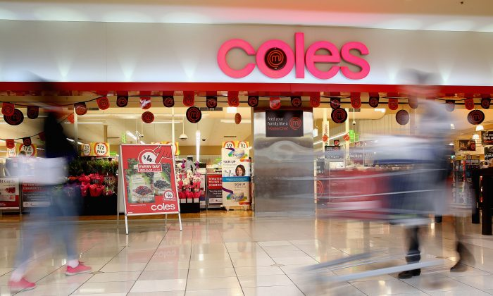 A shopper walks out of Coles supermarket on May 25, 2015 in Melbourne, Australia. (Quinn Rooney/Getty Images)