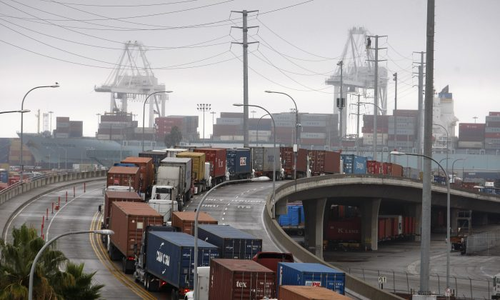 Shipping container trucks sit in traffic at the busiest seaport complex in the nation in Long Beach, Calif., on Nov. 29, 2012. (Photo by David McNew/Getty Images)