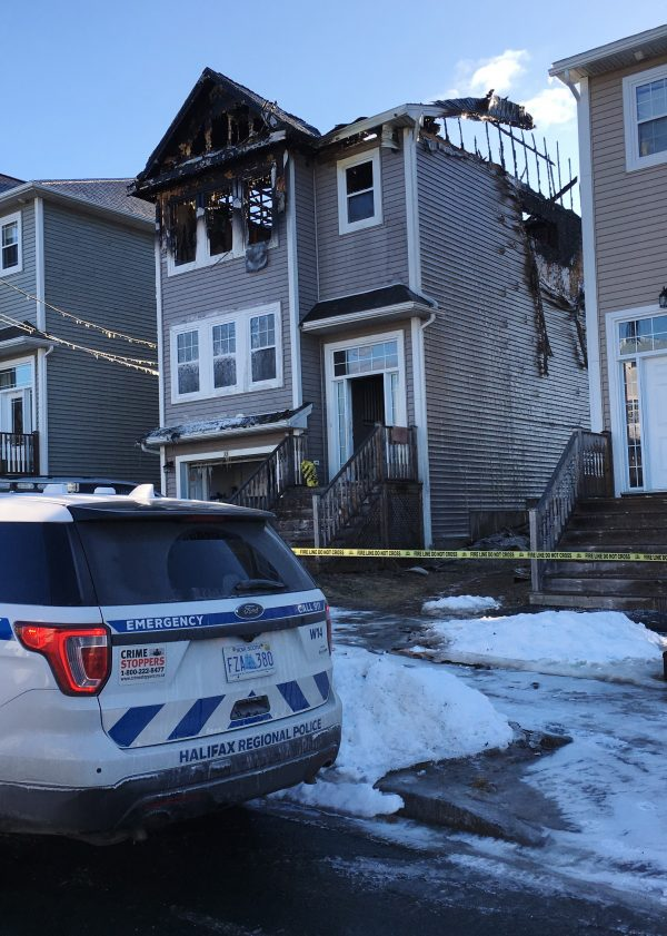 The aftermath of a house fire is seen in the Spryfield community in Halifax on Feb. 19, 2019. Police say firefighters were called to the home around 1 a.m. (The Canadian Press/Rob Roberts)