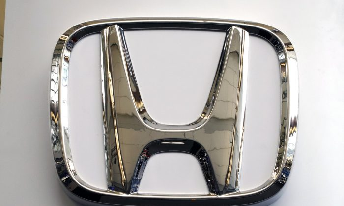 "This Thursday, Feb. 14, 2019 file photo shows the Honda logo on a 2019 Honda Civic on display at the 2019 Pittsburgh International Auto Show in Pittsburgh. Britain's Sky News says Honda is to close a car factory in western England with the potential loss of 3,500 jobs. The broadcaster says the Japanese carmaker will announce Tuesday, Feb. 19 that the Swindon plant, where Honda makes its Civic model, will close in 2022. Honda said Monday that it could not comment ""at this stage."" (Gene J. Puskar/AP Photo)"