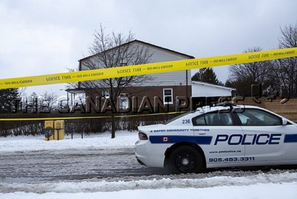 Police tape is seen outside of a house where a young girl was found dead