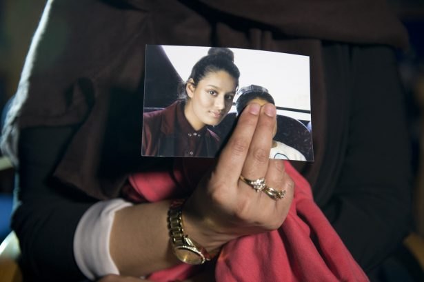 Renu, the eldest sister of Shamima Begum, holds her sister's photo