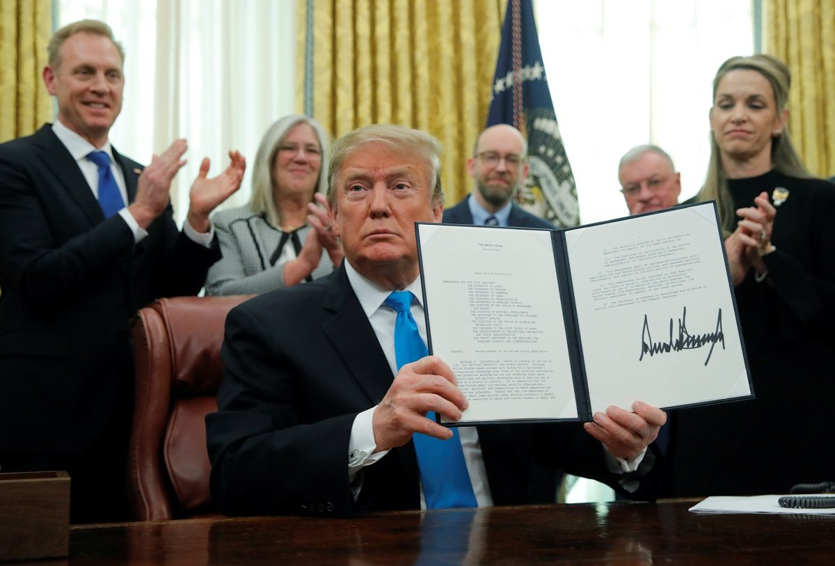 "U.S. President Donald Trump displaus the ""Space Policy Directive 4"" after signing the directive establish a Space Force"