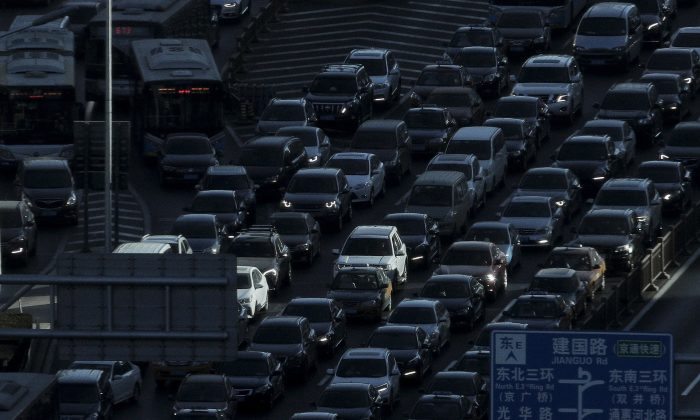Heavy traffic during the morning rush hour in Beijing on Dec. 11, 2018. China's auto sales fell for an eighth month in January 2019, extending a painful decline for the biggest global market. (Andy Wong/AP)