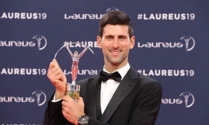 Laureus World Sportsman of The Year 2019 winner Serbia's tennis player Novak Djokovic poses with his award at the 2019 Laureus World Sports Awards ceremony at the Sporting Monte-Carlo complex in Monaco on Feb. 18, 2019. (Valery Hache/AFP/Getty Images)