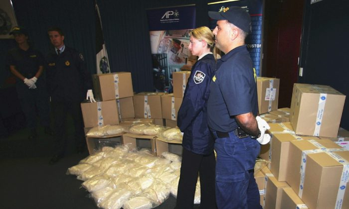 Australian Federal Police display more than one tonne of MDMA (ecstasy) tablets seized from Melbourne's waterfront at the Australian Federal Police Headquarters April 15, 2005 in Melbourne, Australia. The seizure, which has an approximate street value of $250 million, is Australia's largest and one of the worlds biggest ever single detections of the street-ready drug. (Sean Garnsworthy/Getty Images)