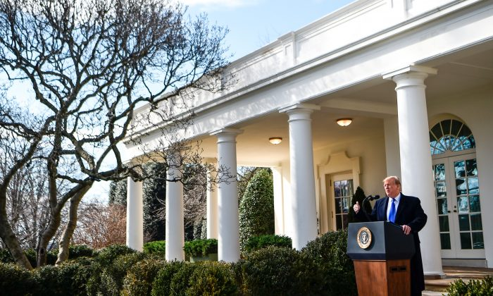 President Donald Trump announces that he will declare a national emergency in order to build a barrier on the U.S.–Mexico border as he delivers remarks at the White House on Feb. 15, 2019.      (BRENDAN SMIALOWSKI/AFP/Getty Images)
