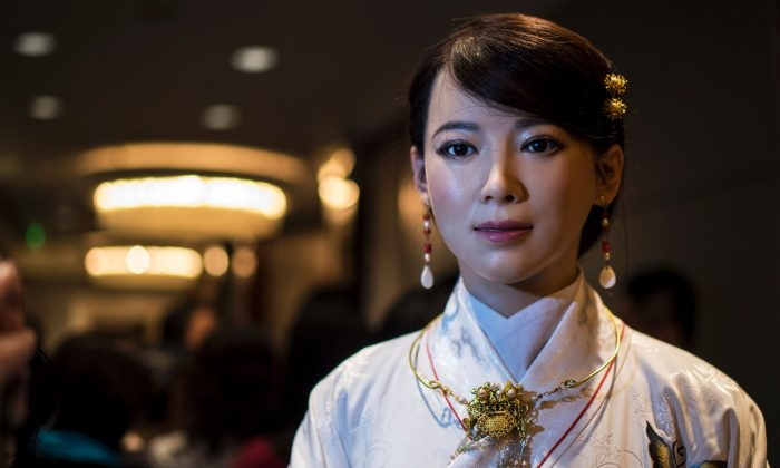 "Humanoid robot Jia Jia, created by a team of engineers from the University of Science and Technology of China, is pictured following a presentation at a conference in Shanghai on Jan. 9, 2017. ""Jia Jia"" can hold a simple conversation and make specific facial expressions.  (Johannes Eisele/AFP/Getty Images)"
