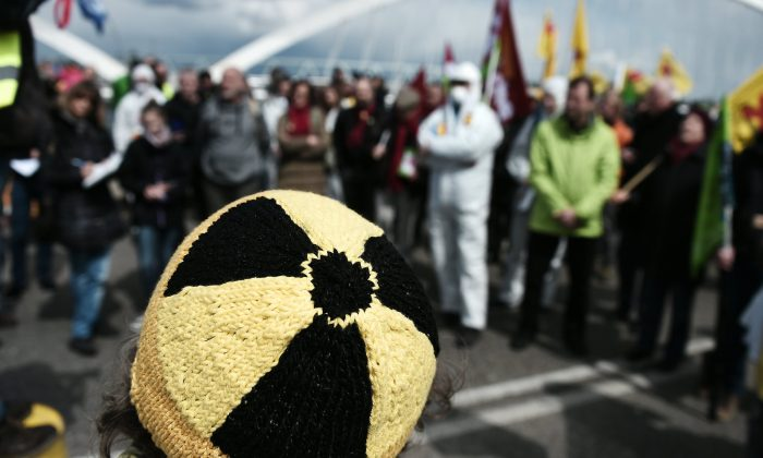 """File photo showing an activist wearing a beanie with a """"radiation"""" symbol at a demonstration in France on April 24, 2016. (Frederick Florin/AFP/Getty Images)"""