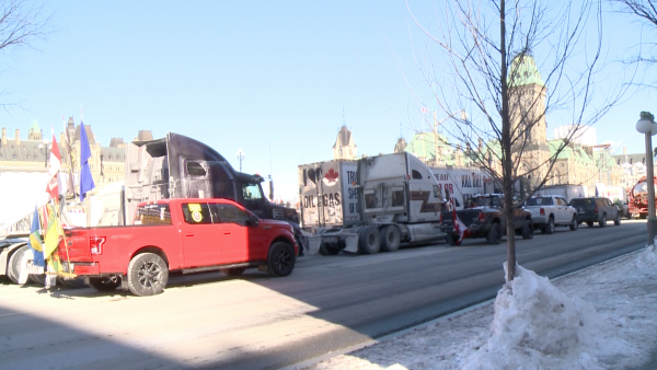 "Trucks and vehicles of the ""United We Roll"" convoy parked in front of Parliament Hill to support Canada's energy sector in Ottawa on Feb. 19, 2019. (NTDTV)"
