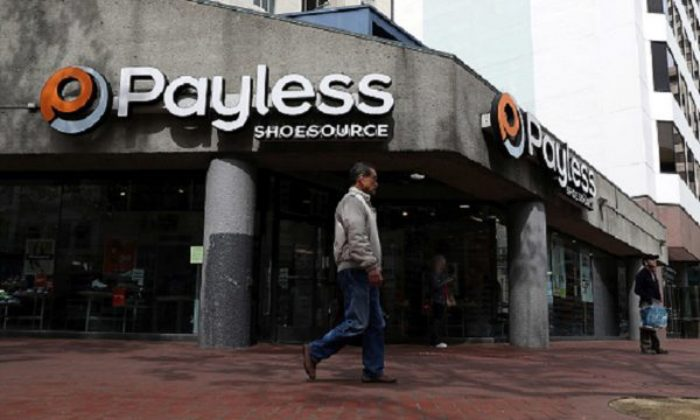 A pedestrian walks by a Payless Shoe Source store  in San Francisco, Calif., on April 5, 2017. (Justin Sullivan/Getty Images)