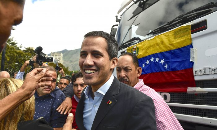 Venezuelan opposition leader and self-declared acting president Juan Guaidó (C), arrives to take part in a demonstration called by the transportation sector to support him, in Caracas, Venezuela, on Feb. 20, 2019. (Federico Parra/AFP/Getty Images)