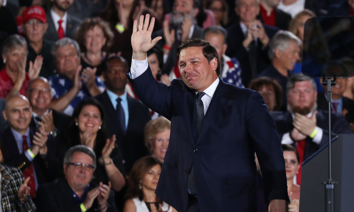 Florida Governor Ron DeSantis waves after speaking about Venezuela before the arrival of President Donald Trump during a rally at Florida International University  on February 18, 2019 in Miami, Florida. (Joe Raedle/Getty Images)