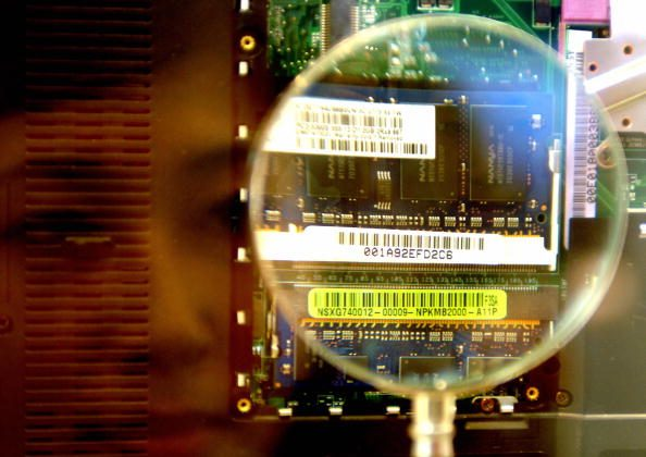 A woman looks through a magnifier to see a 2GB RAM from a notebook during the semi-tech show in Taipei on May 10, 2007. (Sam Yeh/AFP/Getty Images)