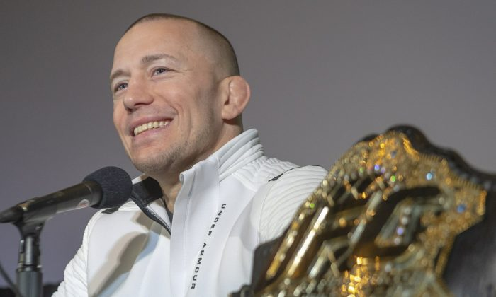 Canada's Georges St-Pierre announces his retirement from mixed martial arts during a press conference in Montreal, on Feb. 21, 2019. (Ryan Remiorz/The Canadian Press via AP)