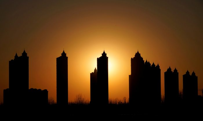 Apartment blocks are pictured during sunset on the outskirts of Tianjin, China on Feb. 2, 2018. (Jason Lee/Reuters)
