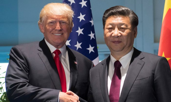 President Donald Trump and Chinese leader Xi Jinping shake hands prior to a meeting on the sidelines of the G20 Summit in Hamburg, Germany, on July 8, 2017. (Saul Loeb/AFP/Getty Images)