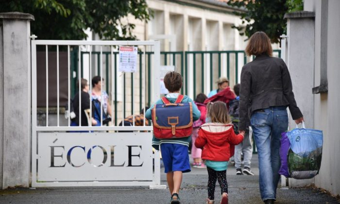 Pupils arrive at a primary school on the first day of the new school year in La Rochelle, France, on Sept. 4, 2017.     XAVIER LEOTY/AFP/Getty Images